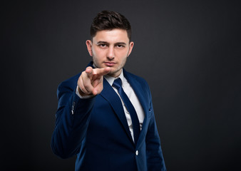 Male entrepreneur making watching you gesture