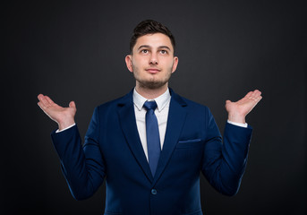 Businessman holding empty hands up