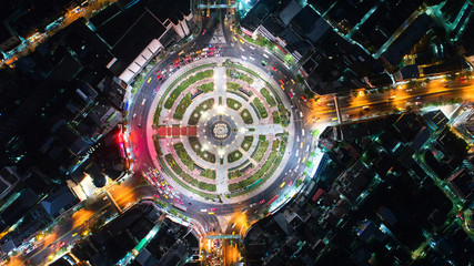Aerial view Road roundabout, Expressway with car lots in the city in Thailand.beautiful Street , downtown,cityscape,Top view. Background,Aerial view city scape