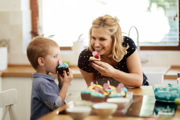 Happy mother and child in kitchen