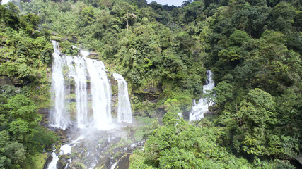 Beautiful waterfall.Tad Khamued Waterfall in southern Laos.It is a place to visit the natural beauty.Mountain forest fall landscape.Top view,Aerial view,amazing nature background,Rainforest