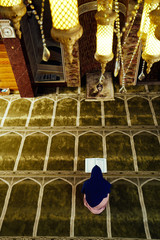 muslim woman praying in mosque