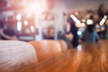 Image of wooden table and abstract blurred background of restaurant, place for your design