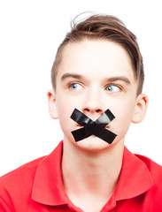 Speechless teen boy  with tape over his mouth