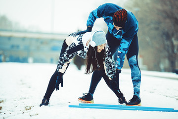 Enthusiastic Love Couple Exercising Outdoors.