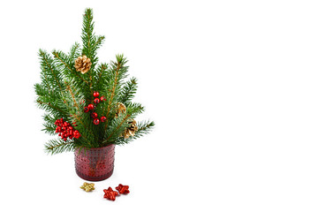 Christmas spruce twig stock images. Simple Christmas decoration. Christmas decoration on a white background. Christmas spruce twig in vase