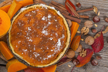 Homemade pie from organically grown pumpkins with autumn fruits