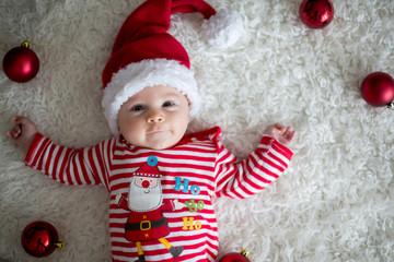 Christmas portrait of cute little newborn baby boy