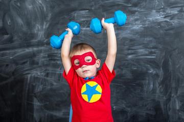 boy superhero with dumbbells