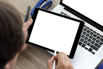 male hands holding tablet and laptop with isolated on screen