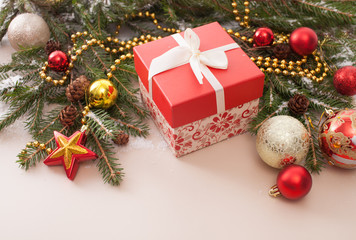 Gift box with a decorated fir tree branches and Christmas balls