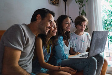 Content family watching laptop at home