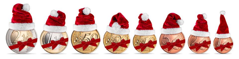 Weihnachtsgeld euro münzen mit weihnachtsmütze und Geschenkband set sammlung isoliert weiß hintergrund / Euro coins christmas santa hat ribbon edition