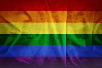 Fabric texture of gay rainbow flag background. A grunge background of the gay flag.
