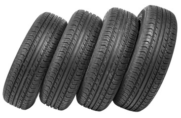 Stack of four wheel new black tyres