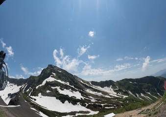 Mountain peaks of the Alps in the snow at summer