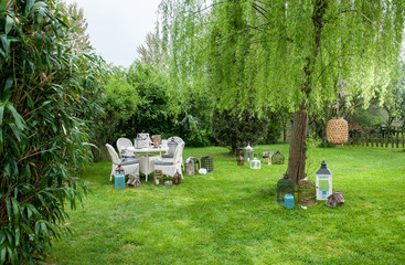 modern garden style with all kind of garden objects chair table and green concept