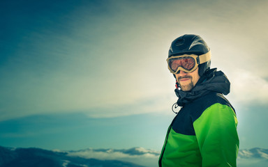 Portrait of a skier in the mountains.