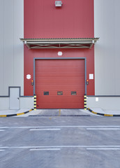 vertical factory gate red color and asphalt