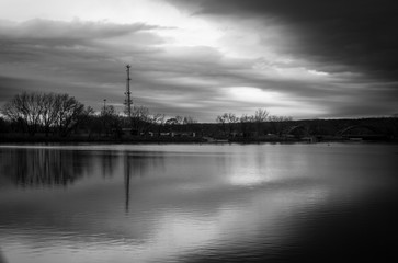 Lake background with moody cloud and sky water reflection. River front with bridge background. Cellular radio tower with overcast moody sky background. Parks and recreation outdoor design.