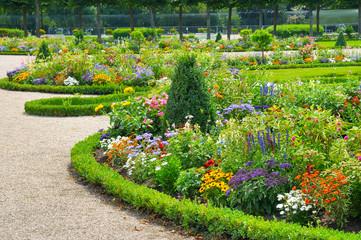 Bright flower bed in summer park.