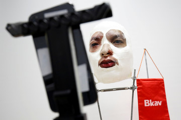 A 3D mask and an iPhone X are seen during a demonstration of recognition ID at the office of Bkav, a Vietnamese cybersecurity firm in Hanoi