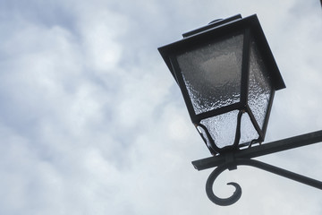 Street light against the autumn sky.