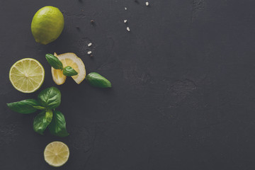 Lime and lemon with mint on black background