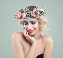 Beautiful Smiling Woman Fashion Model with Blue Eyeshadow Makeup, Pink Roses Flowers and Blonde Bob Hairstyle