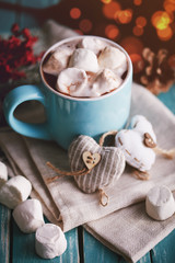Blue mug filled with hot chocolate with marshmallow candies