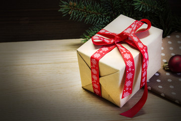 Christmas gift on a wooden background.
