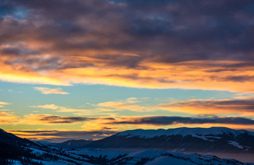 gorgeous sky on winter sunrise in mountains. beautiful nature scenery