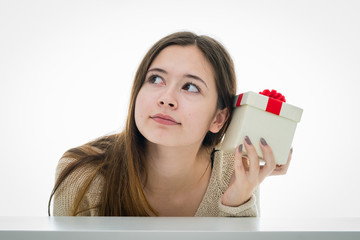 Cheerful and excited teenager with gift box