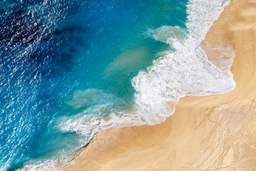 Wall Mural - Aerial view to tropical sandy beach and blue ocean