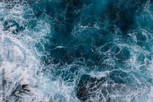 Wall mural Aerial view to ocean waves. Blue water background