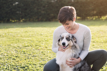Beautiful woman and her dog posing together