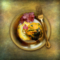 Place setting, plate with pumpkin and hydrangea leaves