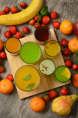 assorted fruit juices with ingredients around