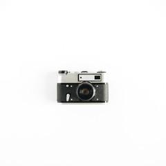 Retro photo camera. Minimalistic hipster flat lay concept.