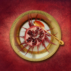 Place setting, plate with pomegranate