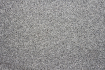 Gray background of woolen textured cloth fabric.