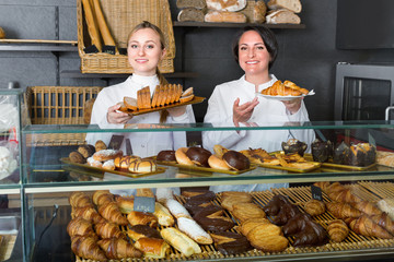 Female cooks demonstrating and selling pastry in the cafe