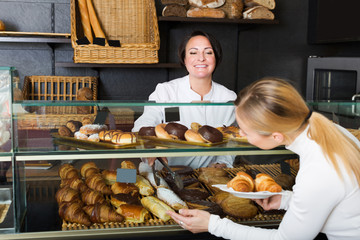 Cook selling pastry to customer