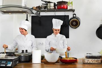 Female chefs preparing food on restaurant kitchen