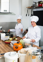 mature and young women cook