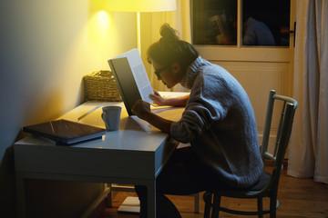 Woman wearing a warm woolen sweater is reading book