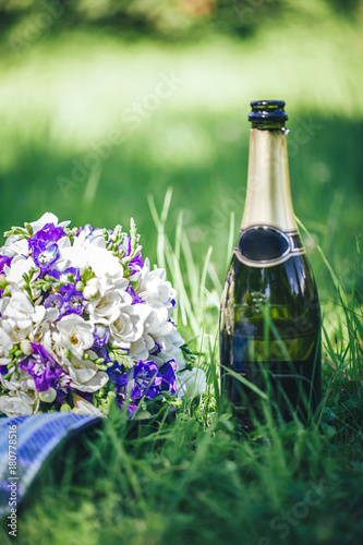 Wedding Bouquet Of Flowers With Blue And White Petals And A Bottle