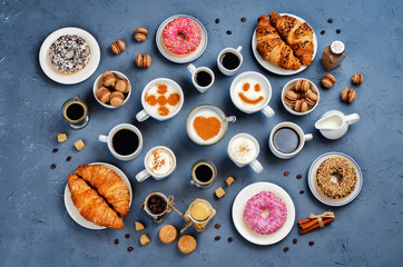 Stone background with different types of coffee and desserts to them
