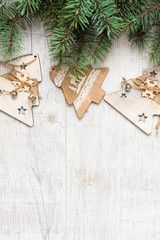Christmas background. Christmas decorations lie on old boards. Fir branches. Handmade decorations. Light boards.