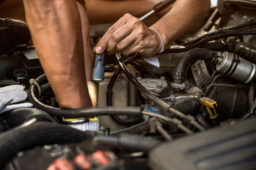 Professional car mechanic working in auto repair service and counseling well